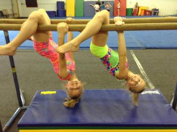 Girls enjoying the parallel bars